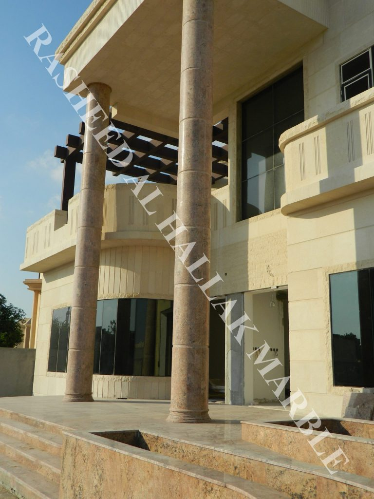 granite 7.3 meters  and onyx bookmatcth curved segmented column at khawaneej – dubai