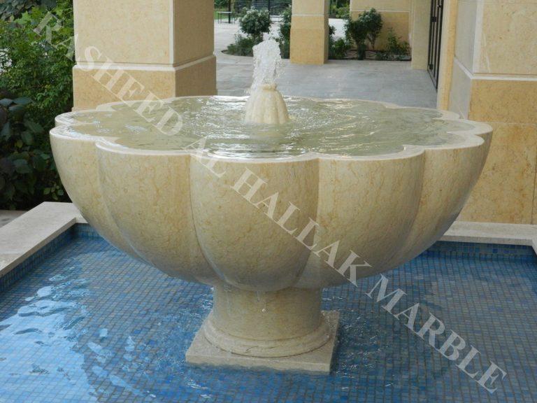 khawaneej villa water fall and garden fountain desert beig stone with mosaics