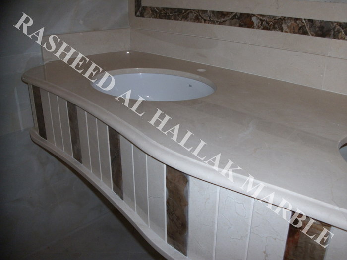 Counter top creama marble with petrified wood inlay and pink onyx inlay